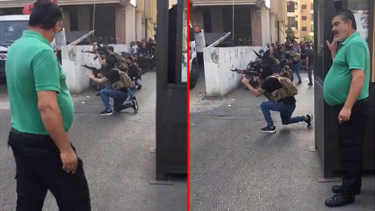 Beyrut'taki silahlı çatışmaların ortasında kalan adam rahat tavırlarıyla dikkat çekti