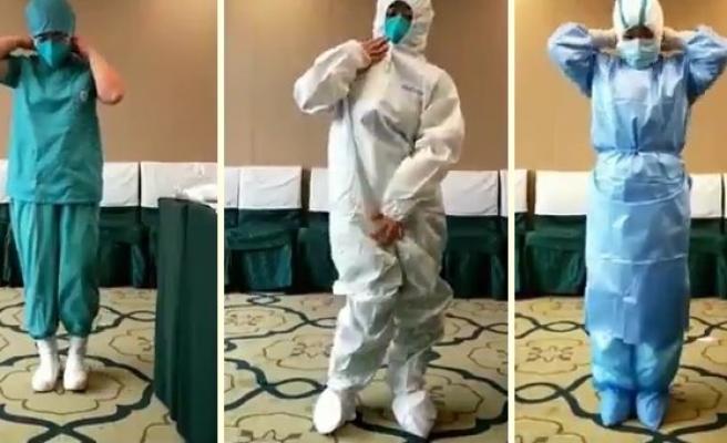 Bir Sağlık Çalışanı, Koronavirüs Vak'asına Bakılırken Nasıl Giyindiğini Gösteren Anların Videosunu Paylaştı