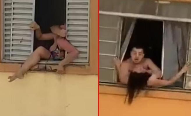 Brezilya'yı ayağa kaldıran görüntü Kocası tarafından darbedilen hamile kadın camdan atlamaya çalıştı