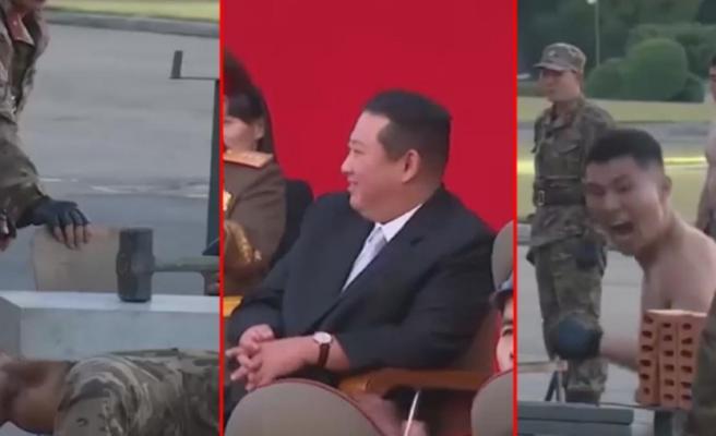Kuzey Kore askerlerinden gövde gösterisi! Betonu yumruklarıyla parçalayıp, cam ve bıçakların üstüne yattılar