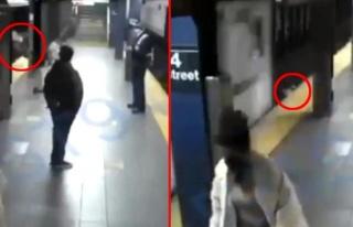 ABD'de evsiz bir adam, tren bekleyen kadını rayların...