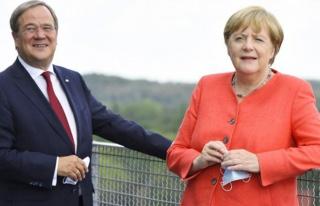 Almanya'da sandık başında Merkel veda ediyor,...