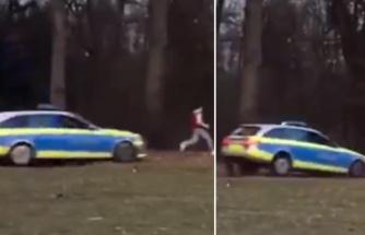 Dünya bu görüntüyü konuşuyor! Polis korona tedbirlerine uymayan genci parkta otomobille kovaladı