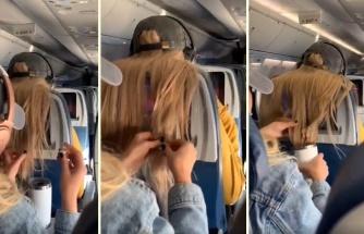 Uçakta Ön Koltuğunda Oturan Kişinin Kendisini Rahatsız Eden Saçlarını Sakıza, Şekere ve Kahveye Bulayan Ruh Hastası Kadın